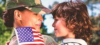 Mom soldier looks at his son with a smile