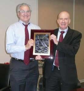 The Lawyer Referal Information Services (LRIS Chair), Joseph H. Rosen presenting the plaque to Immediate Past Chair, Robert E. Turner